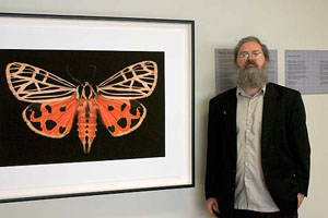 Jim des Rivieres next to 36x24in print of                       Grammia virgo moth